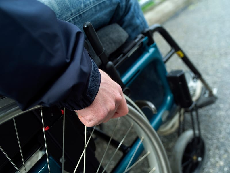 Man in wheelchair. A slip and fall accident can happen anywhere at any time.