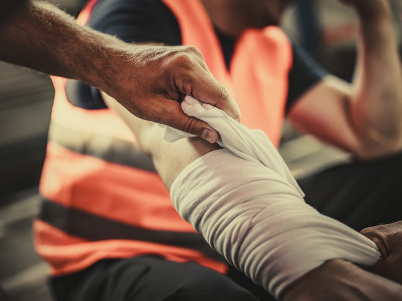 Worker's arm is wrapped after a workplace injury.