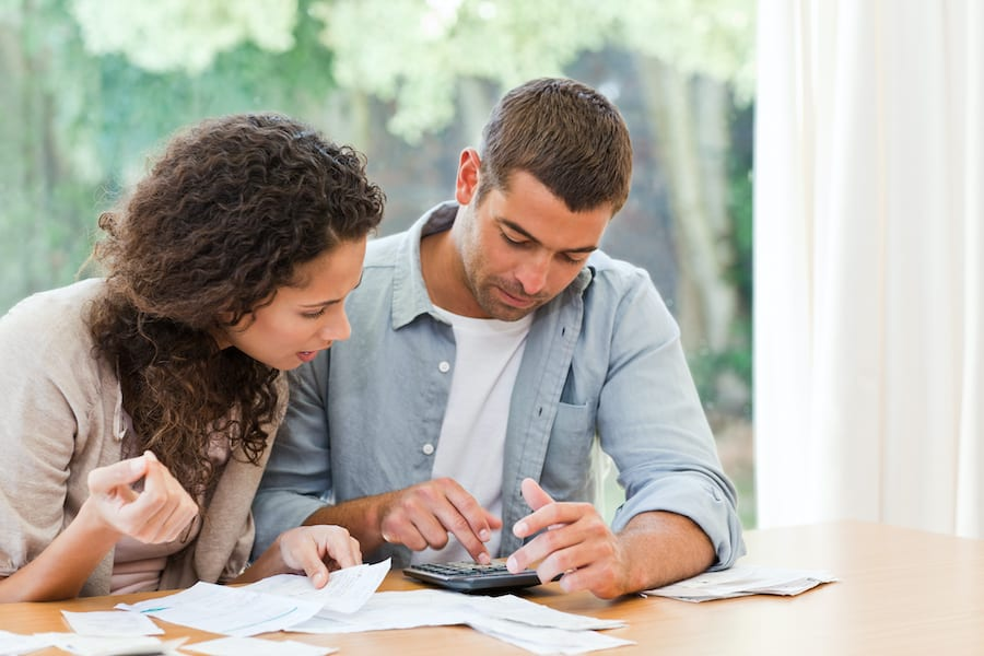 Worried couple paying bills. People fall into difficult financial situations for a variety of reasons, sometimes bankruptcy is the most prudent solution.