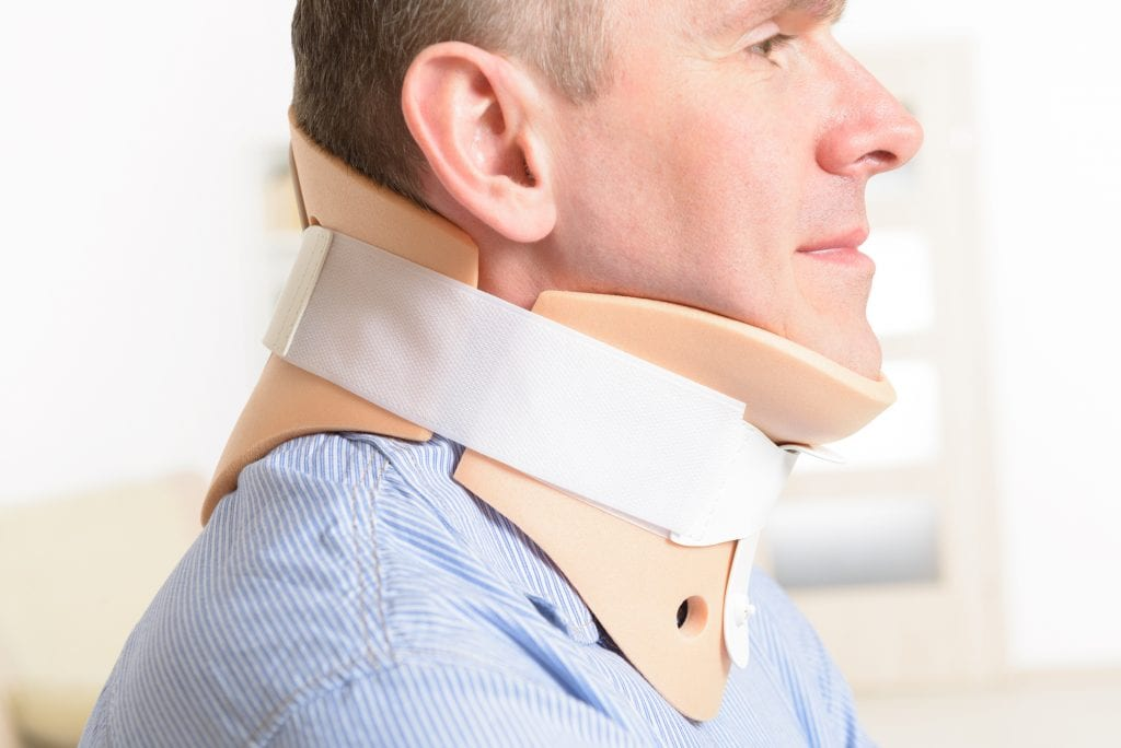 Man with a neck injury wearing a cervical collar. There are many types of accidents that fall under the personal injury law umbrella.